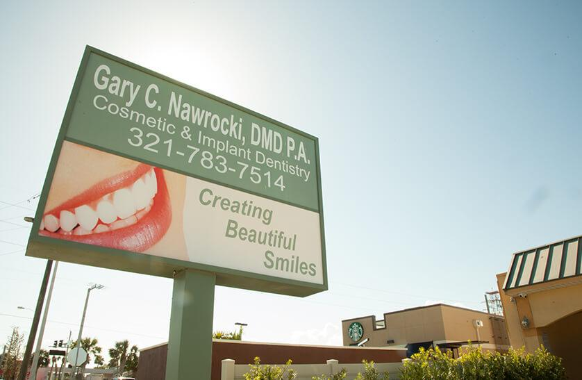 Exterior street sign to Nawrocki Dental in Cocoa Beach