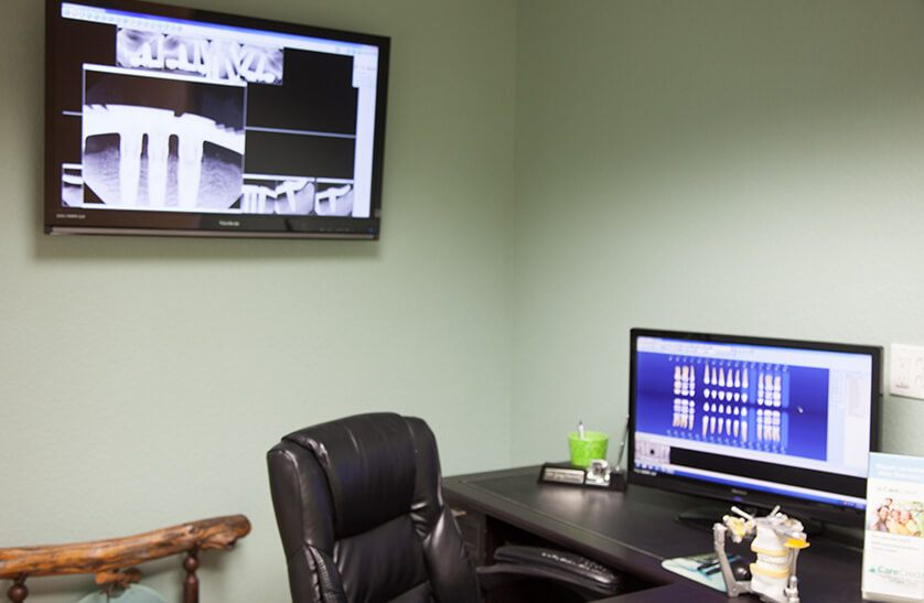 Desk with dental software and imaging