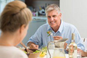 senior man eating food