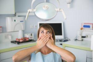 woman afraid of dental chair