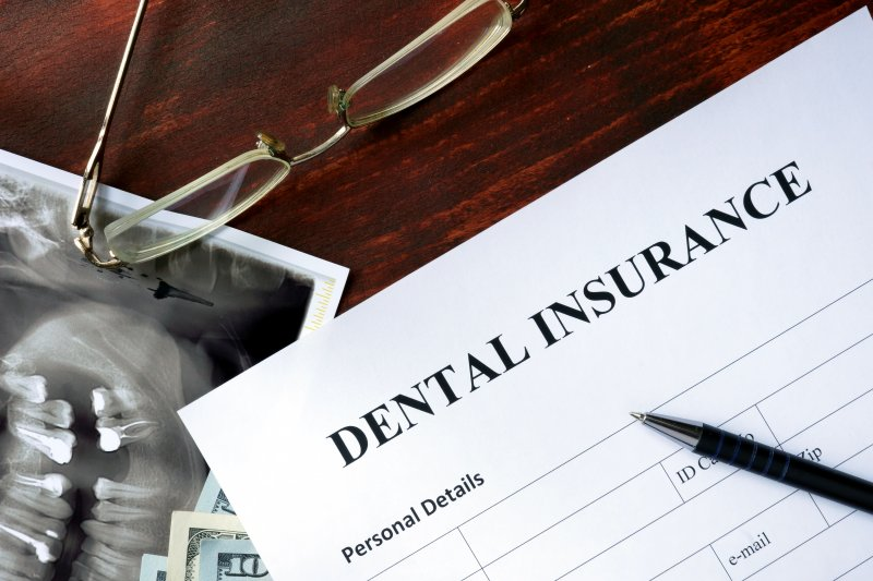 dental insurance form pen glasses
