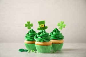 three St. Patrick's Day-themed cupcakes