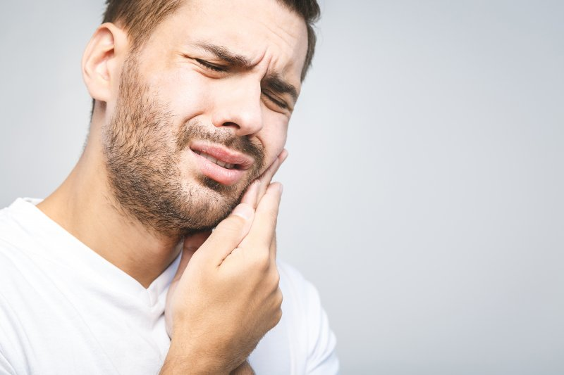 Man with toothache from dental implant failure